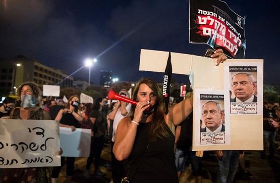 تصدع تحالف نتنياهو وغانتس وتواصل المظاهرات ضدهما