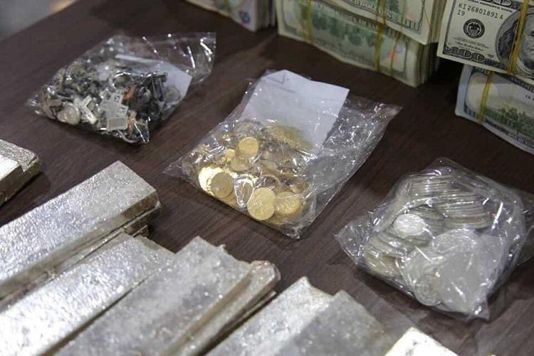 العثور على أموال طائلة وذهب وفضة في الموصل - صور