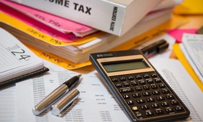 تسوية الأوضاع الضريبيّة لـ 331 شركة ومكلّفا