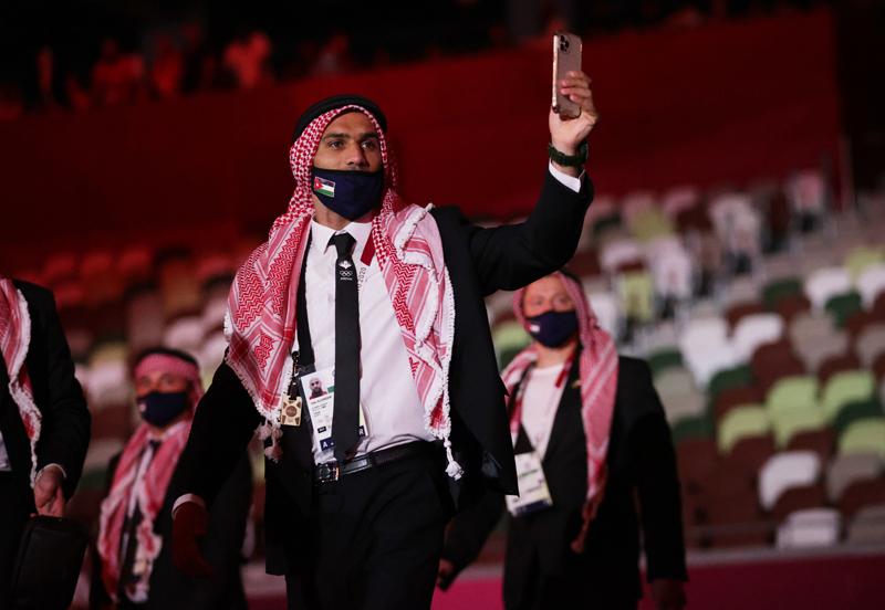 البعثة الأردنية تشارك في حفل افتتاح الأولمبياد - صور